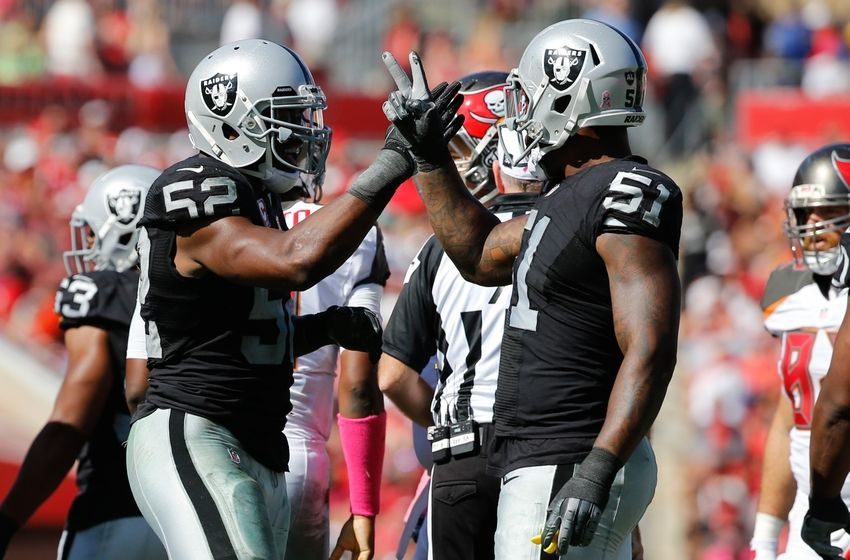 Oct 30, 2016; Tampa, FL, USA; Oakland Raiders defensive end Khalil Mack (52) and outside linebacker Bruce Irvin (51) congratulate each other against the Tampa Bay Buccaneers during the second half at Raymond James Stadium. Oakland Raiders defeated the Tampa Bay Buccaneers 30-24 in overtime. Mandatory Credit: Kim Klement-USA TODAY Sports