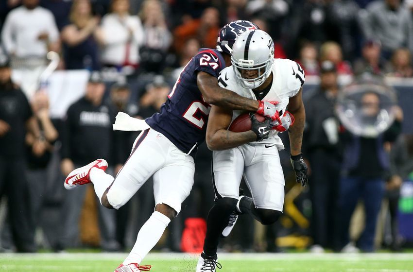 Jan 7, 2017; Houston, TX, USA; Oakland Raiders wide receiver Michael Crabtree (15) is tackled by Houston Texans cornerback Johnathan Joseph (24) during the second quarter of the AFC Wild Card playoff football game at NRG Stadium. Mandatory Credit: Troy Taormina-USA TODAY Sports