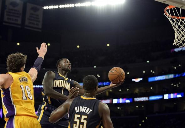 Jan 28, 2014; Los Angeles, CA, USA; Indiana Pacers shooting guard Lance Stephenson (1) shoots against Los Angeles Lakers center Pau Gasol (16) during the second half at Staples Center. Mandatory Credit: Richard Mackson-USA TODAY Sports