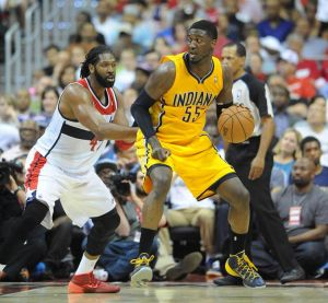 May 9, 2014; Washington, DC, USA; Indiana Pacers center Roy Hibbert (55) dribbles as Washington Wizards power forward Nene Hilario (42) defends during the second half in game three of the second round of the 2014 NBA Playoffs at Verizon Center. The Pacers won 85 - 63. Mandatory Credit: Brad Mills-USA TODAY Sports