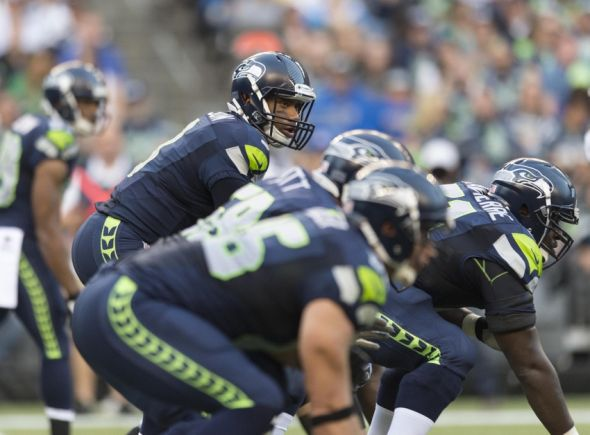 Aug 15, 2014; Seattle, WA, USA; Seattle Seahawks quarterback Russell Wilson (3) during the first half against the San Diego Chargers at CenturyLink Field. Mandatory Credit: Steven Bisig-USA TODAY Sports