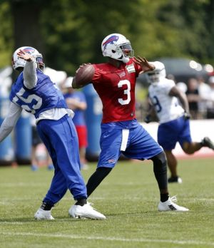 Jul 21, 2014; Pittsford, NY, USA; Buffalo Bills quarterback EJ Manuel (3) drops to pass under pressure by defensive end Jerry Hughes (55) during training camp at St John Fisher College. Mandatory Credit: Kevin Hoffman-USA TODAY Sports