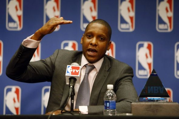 Ujiri demonstrates where the Raptors went (right hand) after the trade while previously they were dragging somewhere near the floor. Mandatory Photo Credit: Chris Humphreys-USA TODAY Sports
