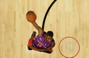 Feb 16, 2013; Houston, TX, USA; The influence of Vince Carter: Toronto Raptors guard Terrence Ross (31) wearing a Carter jersey as he performs a windmill dunk during the 2013 NBA All-Star slam dunk contest at the Toyota Center. Mandatory Credit: Eric Gay/AP via USA TODAY Sports