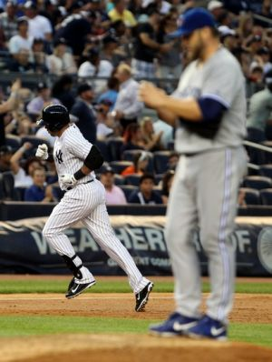 Jul 25, 2014; Bronx, NY, USA; New York Yankees designated hitter Carlos Beltran (36) rounds the bases after hitting a home run off of Toronto Blue Jays starting pitcher Mark Buehrle (56) at Yankee Stadium. Mandatory Credit: Noah K. Murray-USA TODAY Sports