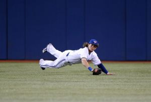 Apr 3, 2013; Toronto, ON, Canada; Toronto Blue Jays center fielder Colby Rasmus (28) makes a diving catch in the eighth inning against the Cleveland Indians at Rogers Centre. The Indians beat the Blue Jays 3-2. Mandatory Credit: Tom Szczerbowski-USA TODAY Sports