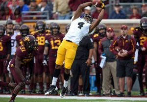 Sep 28, 2013; Minneapolis, MN, USA; Iowa Hawkeyes wide receiver Tevaun Smith (4) catches a pass in the second quarter against the Minnesota Golden Gophers at TCF Bank Stadium. Mandatory Credit: Jesse Johnson-USA TODAY Sports
