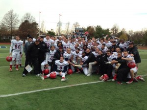 Duquesne football poses for a picture following a 33-23 win against Monmouth.
