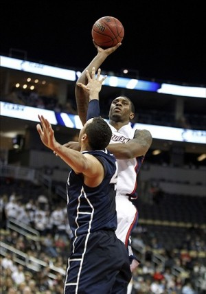 Dec 11, 2013; Pittsburgh, PA, USA; Duquesne Dukes forward Ovie Soko (top) shoots over Penn State Nittany Lions forward Ross Travis (43) during the second half at the CONSOL Center. Penn State won 68-59. Mandatory Credit: Charles LeClaire-USA TODAY Sports