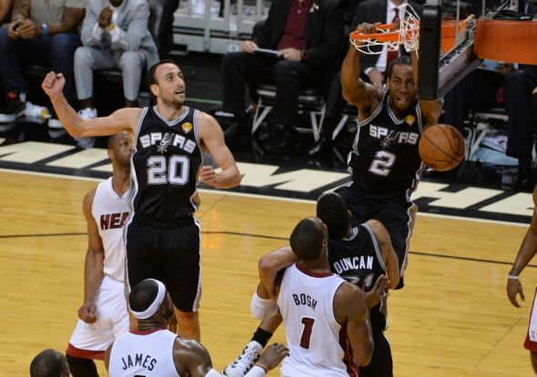 Jun 12, 2014; Miami, FL, USA; San Antonio Spurs forward Kawhi Leonard (2) dunks while defended by Miami Heat center Chris Bosh (1) during the second half of game four of the 2014 NBA Finals at American Airlines Arena. Mandatory Credit: Steve Mitchell-USA TODAY Sports
