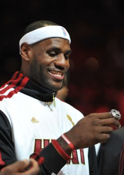 Oct 30, 2012; Miami, FL, USA; Miami Heat small forward LeBron James (6) smiles after receiving his NBA championship ring before a game against the Boston Celtics at American Airlines Arena. Mandatory Credit: Steve Mitchell-USA TODAY Sports