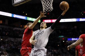Dec 25, 2013; San Antonio, TX, USA; San Antonio Spurs guard Danny Green (4) drives to the basket as Houston Rockets guard Francisco Garcia (32) defends during the first half at AT&T Center. Mandatory Credit: Soobum Im-USA TODAY Sports