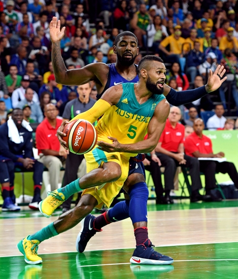 9444503-patty-mills-kyrie-irving-olympics-basketball-men