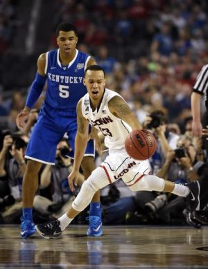 Apr 7, 2014; Arlington, TX, USA; Connecticut Huskies guard Shabazz Napier (13) controls the ball in front of Kentucky Wildcats guard Andrew Harrison (5) during the championship game of the Final Four in the 2014 NCAA Mens Division I Championship tournament at AT&T Stadium. Mandatory Credit: Robert Deutsch-USA TODAY Sports