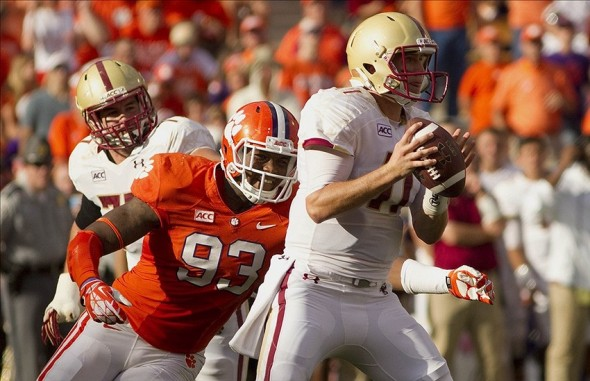 Oct 12, 2013; Clemson, SC, USA; Clemson Tigers defensive end Corey Crawford (93) pressures Boston College Eagles quarterback Chase Rettig (11) during the second quarter at Clemson Memorial Stadium. Mandatory Credit: Joshua S. Kelly-USA TODAY Sports