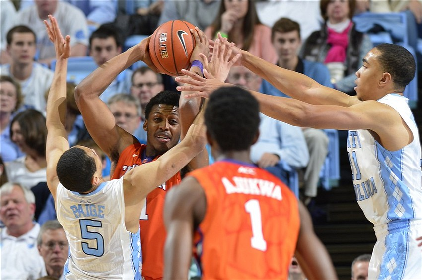 Jan 26, 2014; Chapel Hill, NC, USA; Clemson Tigers guard Damarcus Harrison (21) with the ball as guard/forward Austin Ajukwa (1) looks on and North Carolina Tar Heels guard Marcus Paige (5) and forward Brice Johnson (11) defend in the second half. North Carolina Tar Heels defeated the Clemson Tigers 80-61 at Dean E. Smith Student Activities Center. Mandatory Credit: Bob Donnan-USA TODAY Sports