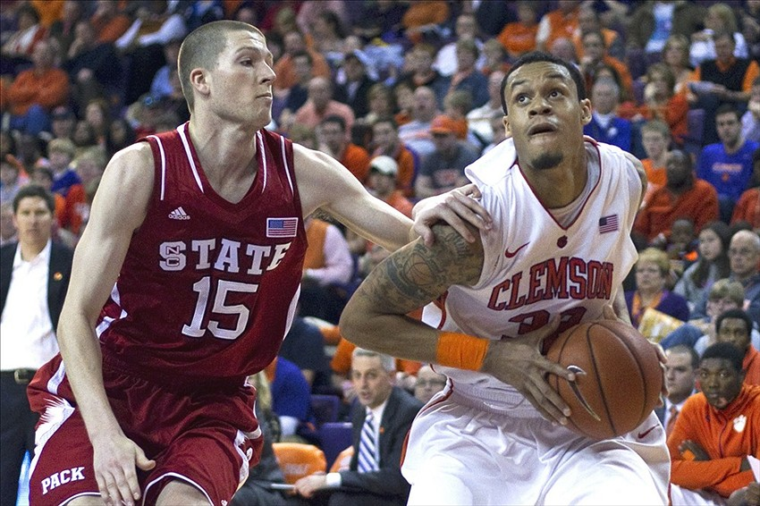 Feb 10, 2013; Clemson, SC, USA; Clemson Tigers forward K.J. McDaniels (32) drives to the basket while being defended by North Carolina State Wolfpack forward Scott Wood (15) during the second half at J.C. Littlejohn Coliseum. Wolfpack won 58-57. Mandatory Credit: Joshua S. Kelly-USA TODAY Sports