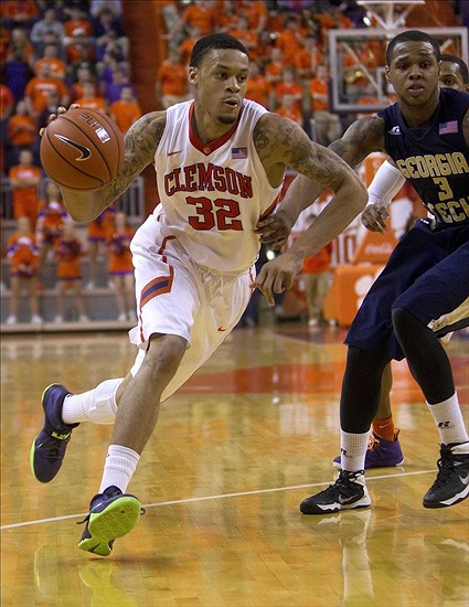 Feb 4, 2014; Clemson, SC, USA; Clemson Tigers forward K.J. McDaniels (32) drives to the basket while being defended by Georgia Tech Yellow Jackets forward Marcus Georges-Hunt (3) during the second half at J.C. Littlejohn Coliseum. Tigers won 45-41. Mandatory Credit: Joshua S. Kelly-USA TODAY Sports