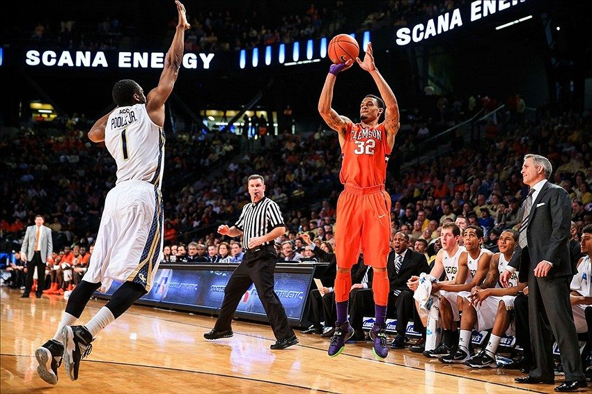 Feb 22, 2014; Atlanta, GA, USA; Clemson Tigers forward K.J. McDaniels (32) shoots a three over Georgia Tech Yellow Jackets guard/forward Stacey Poole, Jr. (1) in the first half at Hank McCamish Pavilion. Mandatory Credit: Daniel Shirey-USA TODAY Sports