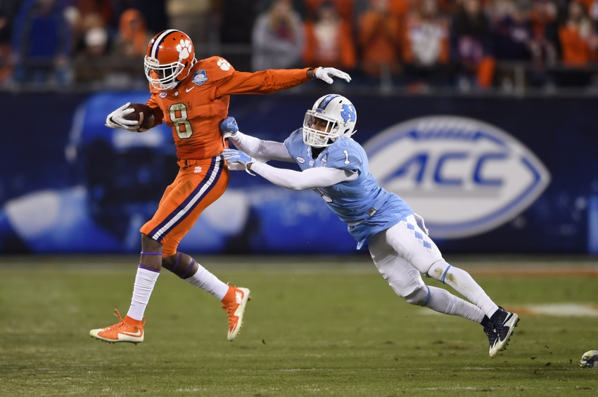 Dec 5, 2015; Charlotte, NC, USA; Clemson Tigers wide receiver Deon Cain (8) with the ball as North Carolina Tar Heels cornerback Mike Hughes (1) defends during the third quarter in the ACC football championship game at Bank of America Stadium. Mandatory Credit: Bob Donnan-USA TODAY Sports