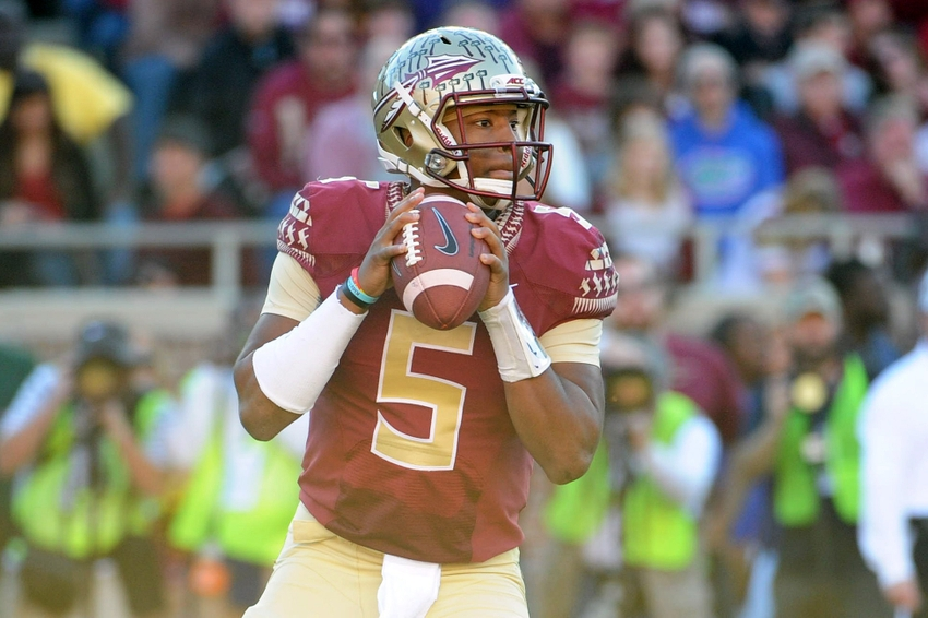 Nov 29, 2014; Tallahassee, FL, USA; Florida State Seminoles quarterback Jameis Winston (5) looks to throw the ball during the first half of the game against the Florida Gators at Doak Campbell Stadium. Mandatory Credit: Melina Vastola-USA TODAY Sports