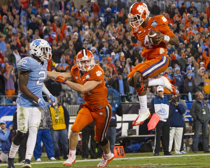 Dec 5, 2015; Charlotte, NC, USA; Clemson Tigers quarterback Deshaun Watson (4) scores a touchdown during the second half in the ACC football championship game against the North Carolina Tar Heels at Bank of America Stadium. ACC Championship Mandatory Credit: Joshua S. Kelly-USA TODAY Sports