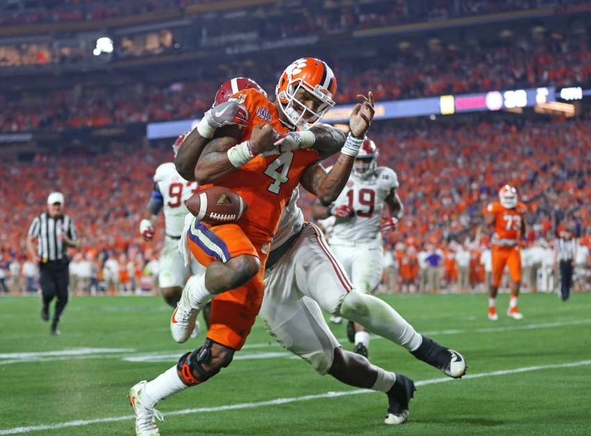 Jan 11, 2016; Glendale, AZ, USA; Alabama Crimson Tide defensive lineman Jarran Reed (90) forces a fumble by Clemson Tigers quarterback Deshaun Watson (4) in the 2016 CFP National Championship at University of Phoenix Stadium. Mandatory Credit: Mark J. Rebilas-USA TODAY Sports