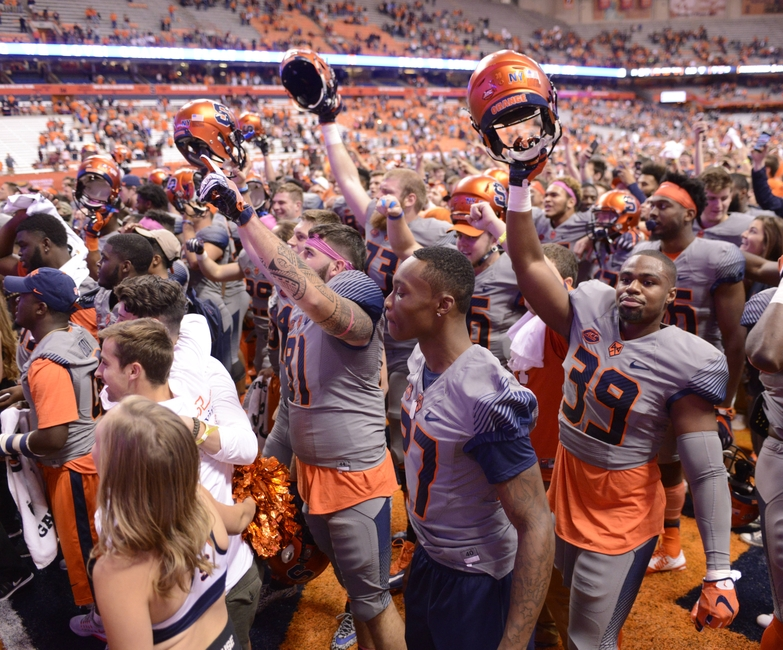 Oct 15, 2016; Syracuse, NY, USA; Syracuse Orange players celebrate a victory over the Virginia Tech Hokies at the Carrier Dome. Syracuse won 31-17. Mandatory Credit: Mark Konezny-USA TODAY Sports