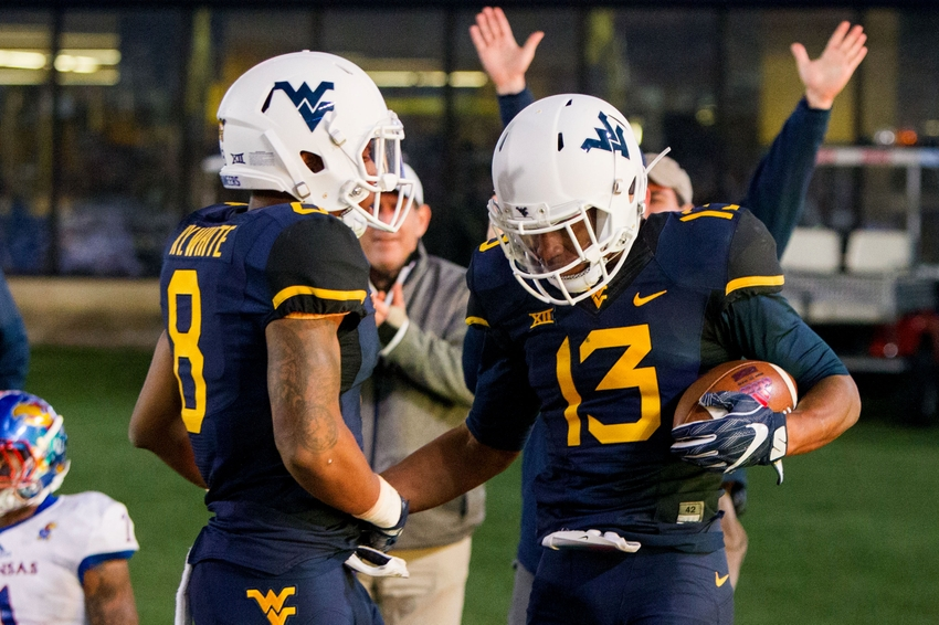 Nov 5, 2016; Morgantown, WV, USA; West Virginia Mountaineers cornerback Rasul Douglas (13) celebrates with safety Kyzir White (8) after intercepting a pass during the fourth quarter against the Kansas Jayhawks at Milan Puskar Stadium. Mandatory Credit: Ben Queen-USA TODAY Sports
