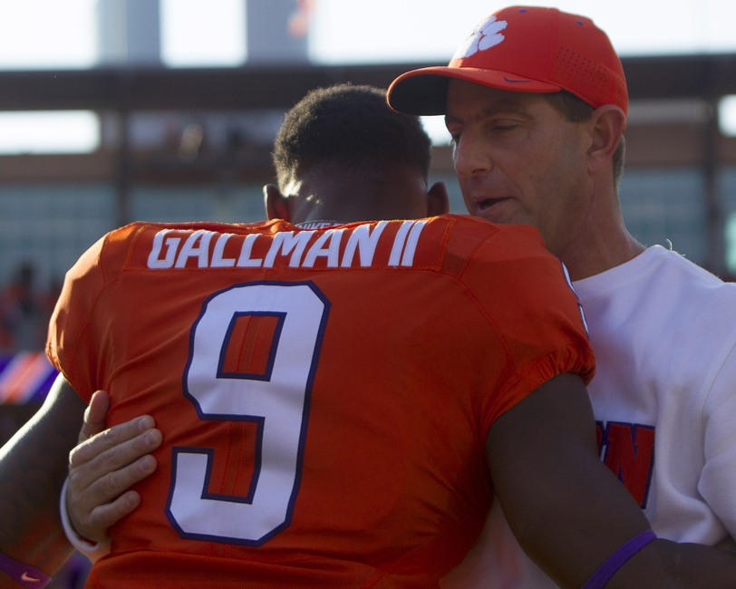 Nov 12, 2016; Clemson, SC, USA; Clemson Tigers running back Wayne Gallman (9) is greeted by head coach Dabo Swinney prior to the start of the game against the Pittsburgh Panthers at Clemson Memorial Stadium. Mandatory Credit: Joshua S. Kelly-USA TODAY Sports