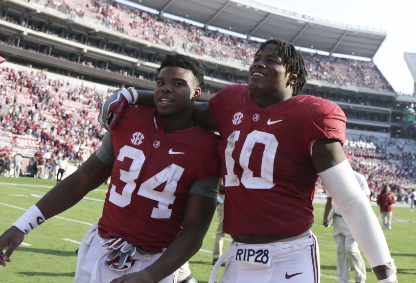 Nov 12, 2016; Tuscaloosa, AL, USA; Alabama Crimson Tide running back Damien Harris (34) and Alabama linebacker Reuben Foster (10) leave the field after his team defeated the Mississippi State Bulldogs at Bryant-Denny Stadium. The Tide defeated the Bulldogs 51-3. Mandatory Credit: Marvin Gentry-USA TODAY Sports