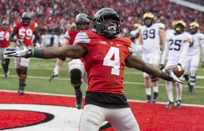 Nov 26, 2016; Columbus, OH, USA; Ohio State Buckeyes running back Curtis Samuel (4) celebrates after scoring the game winning touchdown against the Michigan Wolverines in the second overtime at Ohio Stadium. Ohio State won the game 30-27 in double overtime.Mandatory Credit: Greg Bartram-USA TODAY Sports