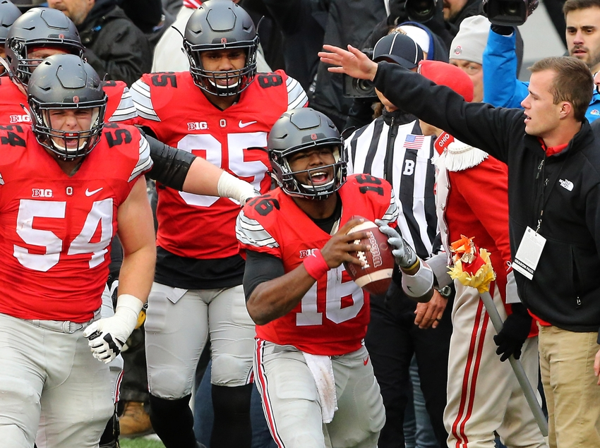 Nov 26, 2016; Columbus, OH, USA; Ohio State Buckeyes quarterback J.T. Barrett (16) celebrates his touchdown with teammate Ohio State Buckeyes offensive lineman Billy Price (54) during the first overtime against the Michigan Wolverines at Ohio Stadium. Ohio State won 30-27. Mandatory Credit: Joe Maiorana-USA TODAY Sports