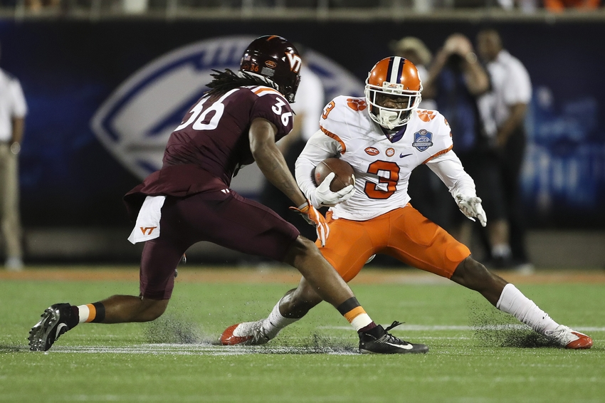 Dec 3, 2016; Orlando, FL, USA; Clemson Tigers wide receiver Artavis Scott (3) runs the ball in the first quarter as Virginia Tech Hokies cornerback Adonis Alexander (36) defends during the ACC Championship college football game at Camping World Stadium. Mandatory Credit: Logan Bowles-USA TODAY Sports