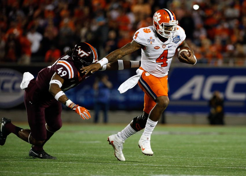 Dec 3, 2016; Orlando, FL, USA; Clemson Tigers quarterback Deshaun Watson (4) stiff arms Virginia Tech Hokies linebacker Tremaine Edmunds (49) during the first half of the ACC Championship college football game at Camping World Stadium. Mandatory Credit: Kim Klement-USA TODAY Sports