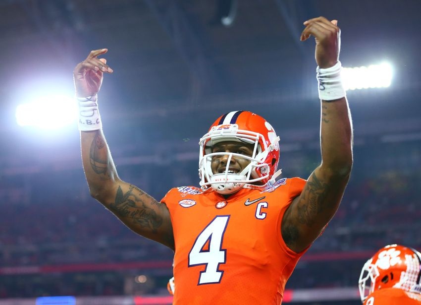 December 31, 2016; Glendale, AZ, USA; Clemson Tigers quarterback Deshaun Watson (4) celebrates a touchdown against the Ohio State Buckeyes in the the 2016 CFP semifinal at University of Phoenix Stadium. Mandatory Credit: Mark J. Rebilas-USA TODAY Sports