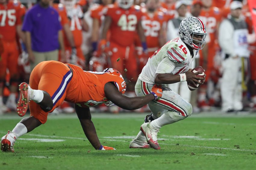 Dec 31, 2016; Glendale, AZ, USA; Ohio State Buckeyes quarterback J.T. Barrett (16) fights to break away from Clemson Tigers defensive tackle Albert Huggins (67) at University of Phoenix Stadium. Mandatory Credit: Matthew Emmons-USA TODAY Sports