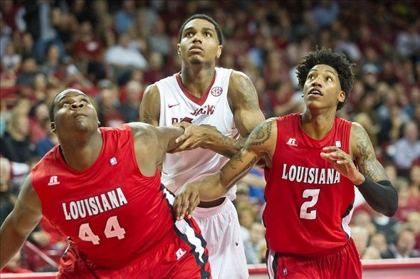 Nov 15, 2013; Fayetteville, Ar, USA; Arkansas Razorbacks forward Coty Clarke (4) is blocked out by Louisiana-Lafayette Ragin