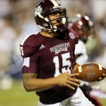 Sep 21, 2013; Starkville, MS, USA; Mississippi State Bulldogs quarterback Dak Prescott (15) celebrates after scoring a touchdown during the game against the Troy Trojans at Davis Wade Stadium. Mandatory Credit: Spruce Derden-USA TODAY Sports