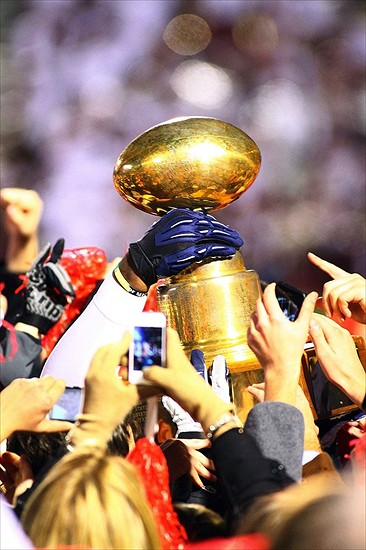 Nov 24, 2012; Oxford, MS, USA; Mississippi Rebels hold the Egg Bowl trophy up after winning the game against the Mississippi State Bulldogs at Vaught-Hemingway Stadium. Mississippi Rebels defeated the Mississippi State Bulldogs 41-24. Mandatory Credit: Spruce DerdenUSA TODAY Sports