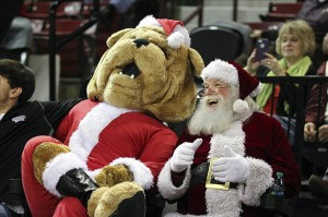 Dec 19, 2013; Starkville, MS, USA; Mississippi State Bulldogs mascot Bully and Santa Clause share a laugh during the game between the Mississippi State Bulldogs and the Florida Gulf Coast Eagles at Humphrey Coliseum. Mississippi State Bulldogs defeat Florida Gulf Coast Eagles 66-53. Mandatory Credit: Spruce Derden-USA TODAY Sports