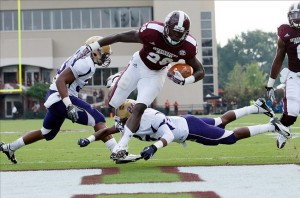 Sep 7, 2013; Starkville, MS, USA; Mississippi State Bulldogs running back Derrick Milton (28) scores a touchdown against the Alcorn State Braves at Davis Wade Stadium. Mandatory Credit: Marvin Gentry-USA TODAY Sports