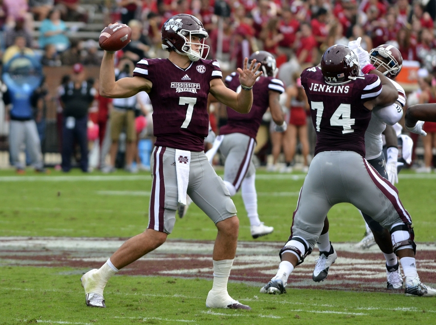 Oct 10, 2015; Starkville, MS, USA; Mississippi State Bulldogs quarterback Nick Fitzgerald (7) makes a pass during the second quarter of the game against the Troy Trojans at Davis Wade Stadium. Mississippi State won 45-17. Mandatory Credit: Matt Bush-USA TODAY Sports