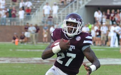 Sep 19, 2015; Starkville, MS, USA; Mississippi State Bulldogs running back Aeris Williams (27) runs the ball during the game against the Northwestern State Demons at Davis Wade Stadium. Mississippi State won 62-13. Mandatory Credit: Matt Bush-USA TODAY Sports