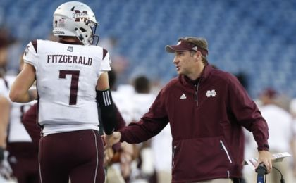 Sep 24, 2016; Foxborough, MA, USA;  Mississippi State Bulldogs head coach Dan Mullen congratulates quarterback Nick Fitzgerald (7) after a touchdown during the third quarter against the Massachusetts Minutemen at Gillette Stadium. Mississippi State won 47-35. Credit: Greg M. Cooper-USA TODAY Sports
