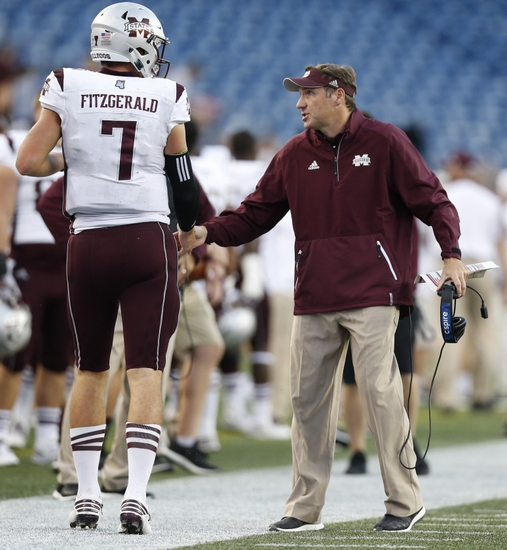 9562108-dan-mullen-nick-fitzgerald-ncaa-football-mississippi-state-massachusetts