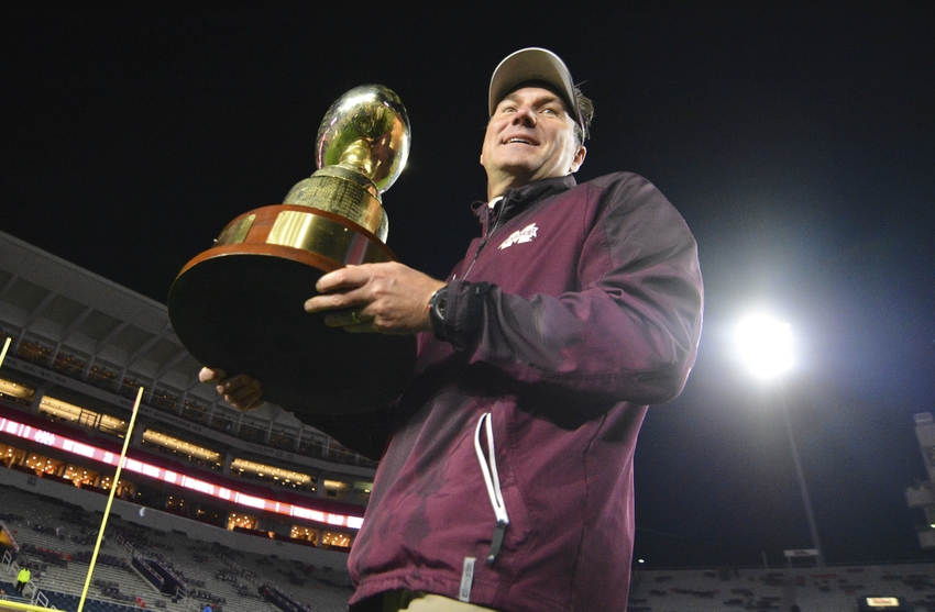 Nov 26, 2016; Oxford, MS, USA; Mississippi State Bulldogs head coach Dan Mullen carries the Egg Bowl trophy after the game against the Mississippi Rebels at Vaught-Hemingway Stadium. Mississippi State won 55-20 Mandatory Credit: Matt Bush-USA TODAY Sports