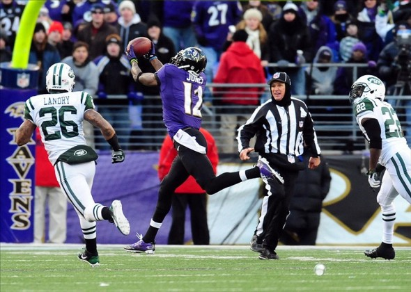 Nov 24, 2013; Baltimore, MD, USA; Baltimore Ravens wide receiver Jacoby Jones (12) catches a 66 yard touchdown pass in front of New York Jets safeties Ed Reed (22) and Dawan Landry (26) at M