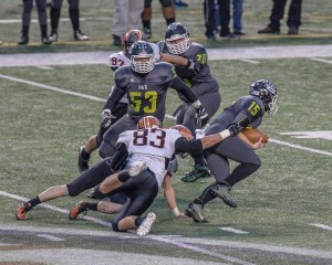 Rick Leonard (8) on the sack ... Photo by Wayne Lee Dutrow