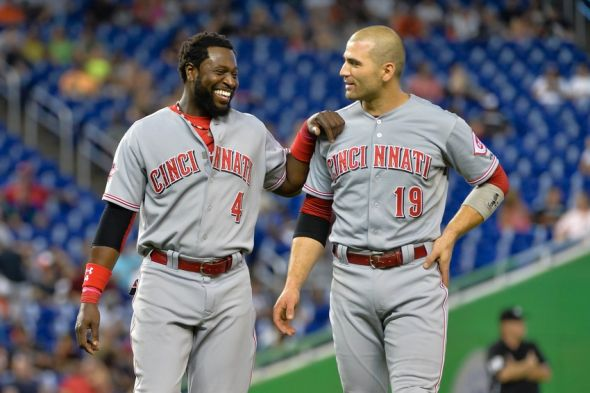Jul 11, 2015; Miami, FL, USA; Cincinnati Reds second baseman Brandon Phillips (left) talks with first baseman Joey Votto (right) during the fifth inning against the Miami Marlins at Marlins Park. Mandatory Credit: Steve Mitchell-USA TODAY Sports